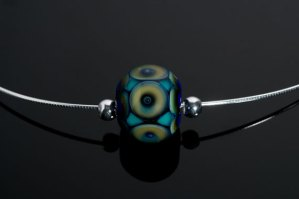 "Becky Congdon ""Peacock Eyes Omega"" Necklace $95. SOLD (photo by Ann Cady)"