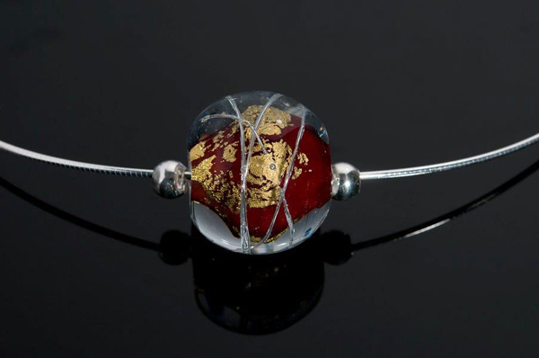 "Becky Congdon ""Red Cosmos Omega"" handmade flameworked glass bead with gold leaf and sterling silver findings/chain 18"" $95. Inquire on availability (photo by Ann Cady)"