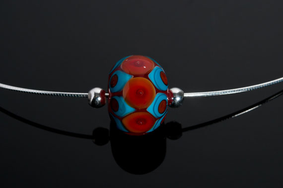 "Becky Congdon ""Red Turquoise Eyes Omega"" handmade flameworked glass bead with sterling silver findings/chain 18"" $95. Inquire on availability (photo by Ann Cady)"