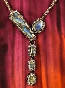 "San Fortune ""Labradorite Falls Necklace"" (view A) 5 labradorite stones bezeled with various size glass seed beads with handmade chenille stitched rope $460."