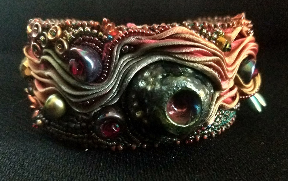 """Ann Recotta """"Eruption"""" (View B) 1.5"""" wide cuff with bead embroidery and bead weaving $200."""