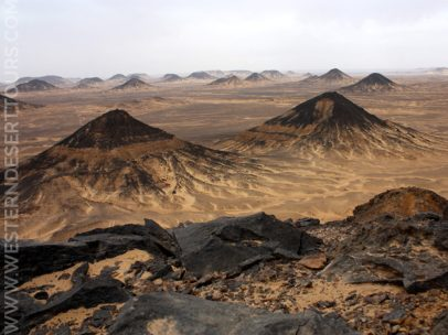 The small, black-topped hills of the Black Desert