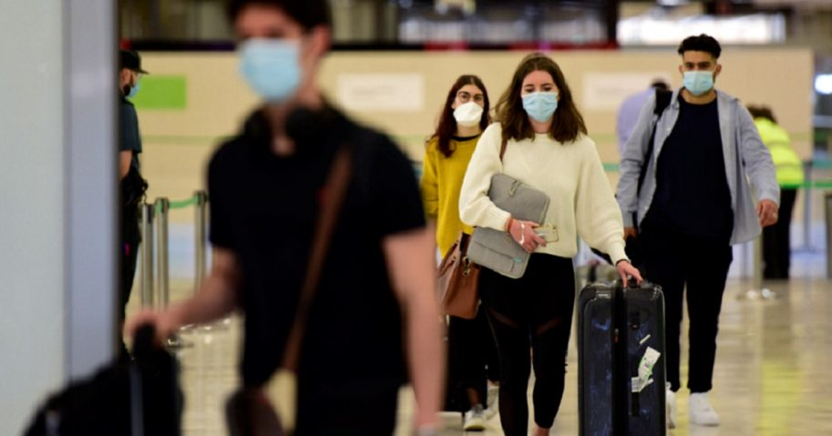 Travelers leave the arrivals terminal at the Adolfo Suarez Madrid Barajas airport Sunday in Madrid, Spain.