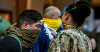 Sailor assigned to the aircraft carrier USS Theodore Roosevelt, who have tested negative for COVID-19, have their temperatures checked at local hotels in Guam in an effort to implement social distancing.