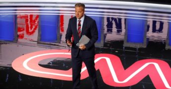 Jake Tapper speaks before the first of two Democratic presidential primary debates hosted by CNN Tuesday, July 30, 2019, in the Fox Theatre in Detroit.