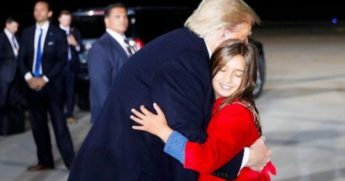 President Donald Trump hugs 9-year-old granddaughter Arabella.