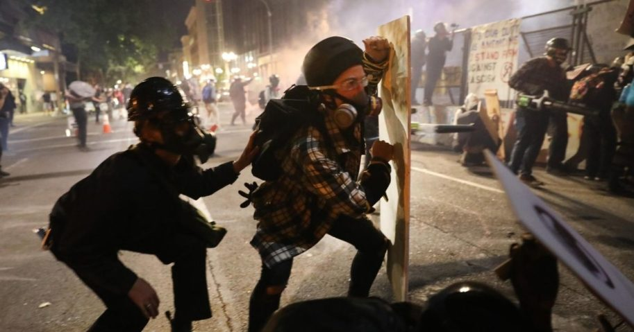 Rioters clash with federal agents on July 28 outside the Mark O. Hatfield federal courthouse in downtown Portland,
