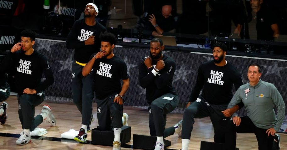 LeBron James, fourth from left, of the Los Angeles Lakers does the Wakanda salute during a moment of silence to honor the death of actor Chadwick Boseman before the start of Game Five of the Western Conference First Round against the Portland Trail Blazers during the 2020 NBA Playoffs at AdventHealth Arena on Aug. 29, 2020, in Lake Buena Vista, Florida.