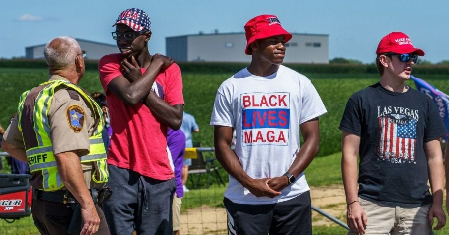 Supporters of President Donald Trump wear America-themed apparel on Aug. 17, 2020, in Mankato, Minnesota, as the president delivers remarks on jobs and the economy.