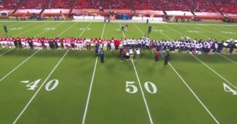 "Players and coaches from the Houston Texans and Kansas City Chiefs gather midfield for a ""moment of silence"" before the first game of the 2020-2021 NFL season."