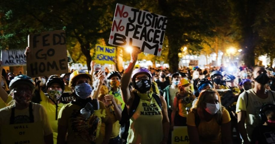 People gather to protest in front of the Mark O. Hatfield federal courthouse in downtown Portland, Oregon, as the city experiences another night of unrest on July 27, 2020.