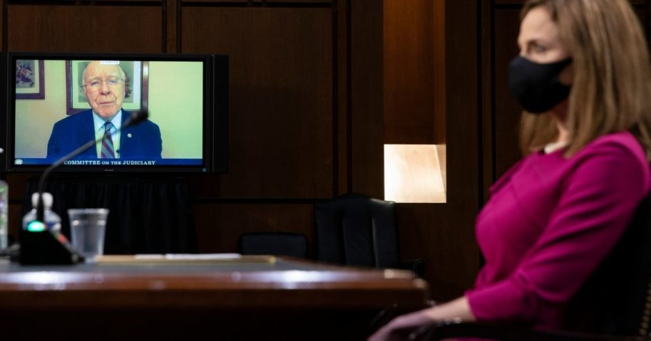 Democratic Sen. Patrick Leahy of Vermont gives his opening statement by video as Judge Amy Coney Barrett looks on during the first day of her Supreme Court confirmation hearing Monday in Washington, D.C.