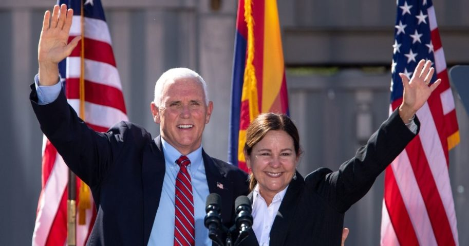 """Vice President Mike Pence and second lady Karen Pence wave to supporters during a """"Make America Great Again"""" event at TYR Tactical in Peoria, Arizona, on Thursday."""