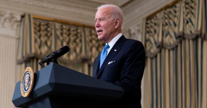 President Joe Biden speaks in the State Dining Room of the White House on Tuesday in Washington, D.C.