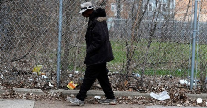 An unidentified man walks down Michigan Ave. in Chicago's Bronzeville neighborhood on April 6, 2020.