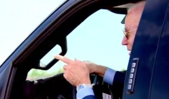 President Joe Biden jokingly threatened to run over a reporter who attempted to ask him about the tense situation in Israel on Tuesday as he test-drove a Ford truck in Michigan.