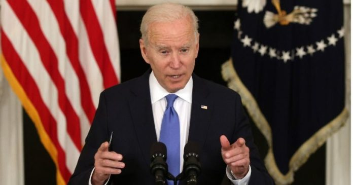 President Joe Biden speaks during an event at the State Dining Room of the White House on Wednesday in Washington, D.C.