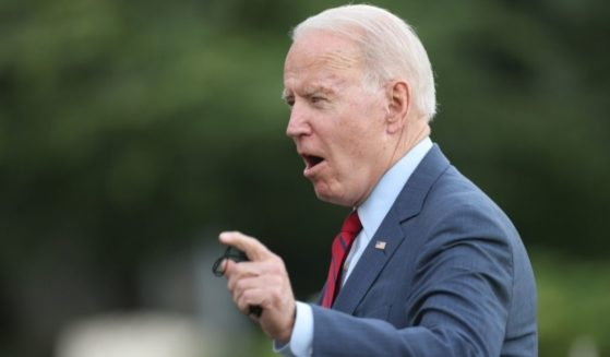 President Joe Biden gestures to reporters as he returns to the White House on Thursday in Washington, D.C.