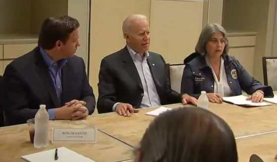 President Joe Biden, center, discusses the emergency situation in Miami, as crews are working to pull people from the rubble of the Champlain Towers South condominium building collapse in Surfside, Florida.