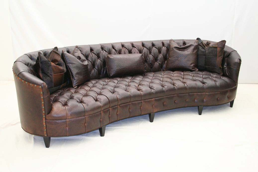 curved tufted leather sofa