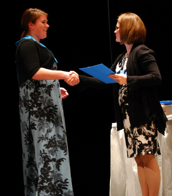 Julia Masson, a sophomore from Westford, is inducted into the Nashoba Valley Technical High School National Honor Society by Principal Denise Pigeon during a recent induction ceremony in the Westford school's Performing Arts Center. (courtesy Dan Phelps)