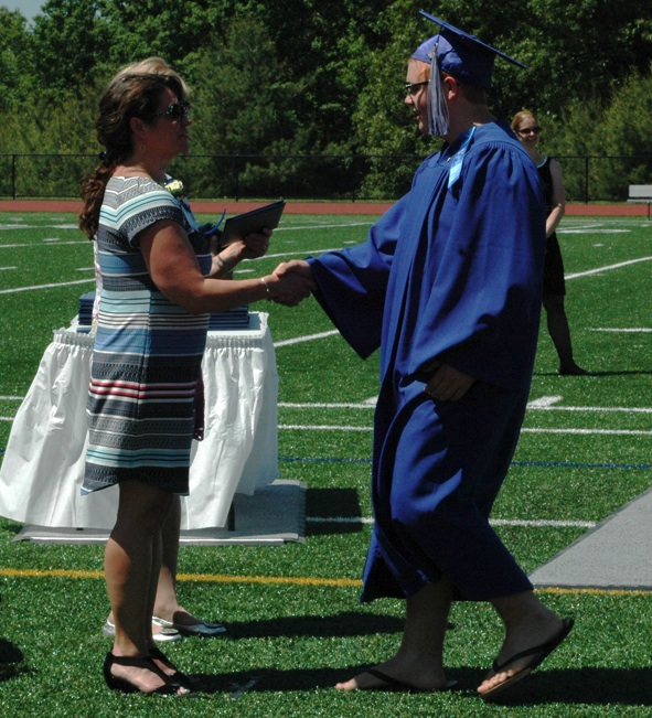 Joseph Clark of Westford receives his diploma from Nashoba Tech School Committee Chairwoman Jennifer Rhodes. (Credit: Derek Rochon)