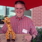 Charles Stark had a sign with a giraffe
