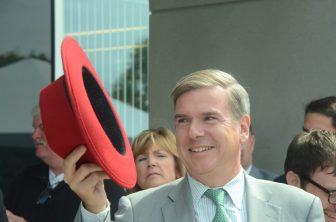 Massachusetts Housing and Development Secretary Greg Bialecki was awarded by Red Hat with their trademark fedora.