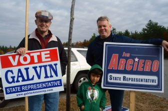 John Cunningham (left) and Jim Healy with his son, Lorenzo at about 12:30 p.m. on Election Day outside of the Stony Brook School