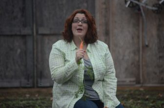 Andrea Watson sings into a carrot for a good cause.