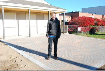 Nick Anderson and the new patio area he constructed near the Nashoba Tech concession stand. (courtesy - Dan Phelps)