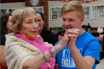 """Bridges resident Anne Lawson takes the lead while dancing with Nicholas Anderson, a junior from Chelmsford, during the """"Senior Prom"""" that Nashoba Tech's Health Assisting program held for residents of the assisted-living facility. (Courtesy - Dan Phelps)"""