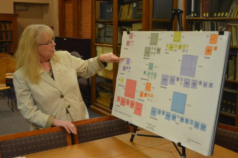 J.V. Fletcher Library Director Ellen Rainville points at a schematic  design comparing area usage in the current and future libraries.  WESTFORDCAT PHOTO