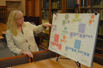 J.V. Fletcher Library Director Ellen Rainville points at a schematic comparing area usage in the current and future libraries.
