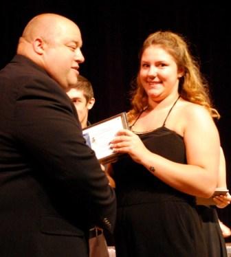 Crystal Perkins of Westford receives an award from Assistant Principal Matthew Ricard during Nashoba Tech's recent Senior Awards Night.