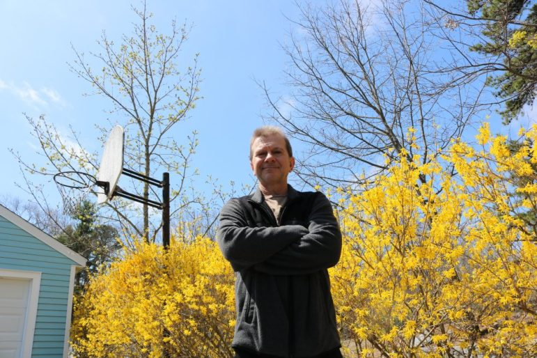 Ray Zerkle stands in his driveway at 17 Jonas Road. A proposed 140 foot cellular facility for 73 Brookside Road would be visible directly behind him, he said. PHOTO BY JOYCE PELLINO CRANE