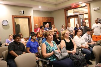 Supporters of the proposed dog park spill over into the back of Town Hall's meeting room. PHOTO BY JOYCE PELLINO CRANE