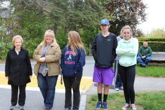 A group watches the Apple Blossom Parade this spring. Behind them is a yellow crosswalk in the town center that will soon be painted white. PHOTO BY JOYCE PELLINO CRANE