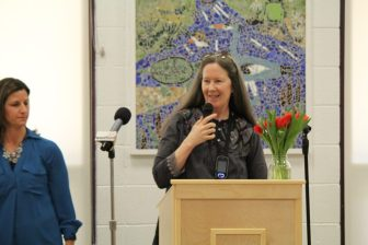 Artist Lizz Van Saun addresses the Day School community at an unveiling of the mosaic art pieces on Jan. 31. PHOTO BY SARAH FLETCHER