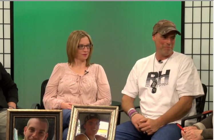 Dawn Trask and Ryan Troy Tripp with photos of their sons. WESTFORDCAT PHOTO