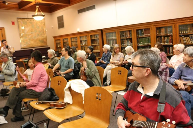 Attendees of a library class on playing the ukulele on April 21. PHOTO BY JOYCE PELLINO CRANE
