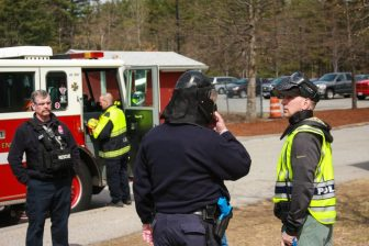 Public safety officials review their crisis plan at a school security drill at Westford Academy on April 18. PHOTO BY ANTHONY CAMMALLERI