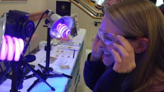 A student at Westford Academy views her skin for signs of cancer under an ultra-violet light. COURTESY PHOTO