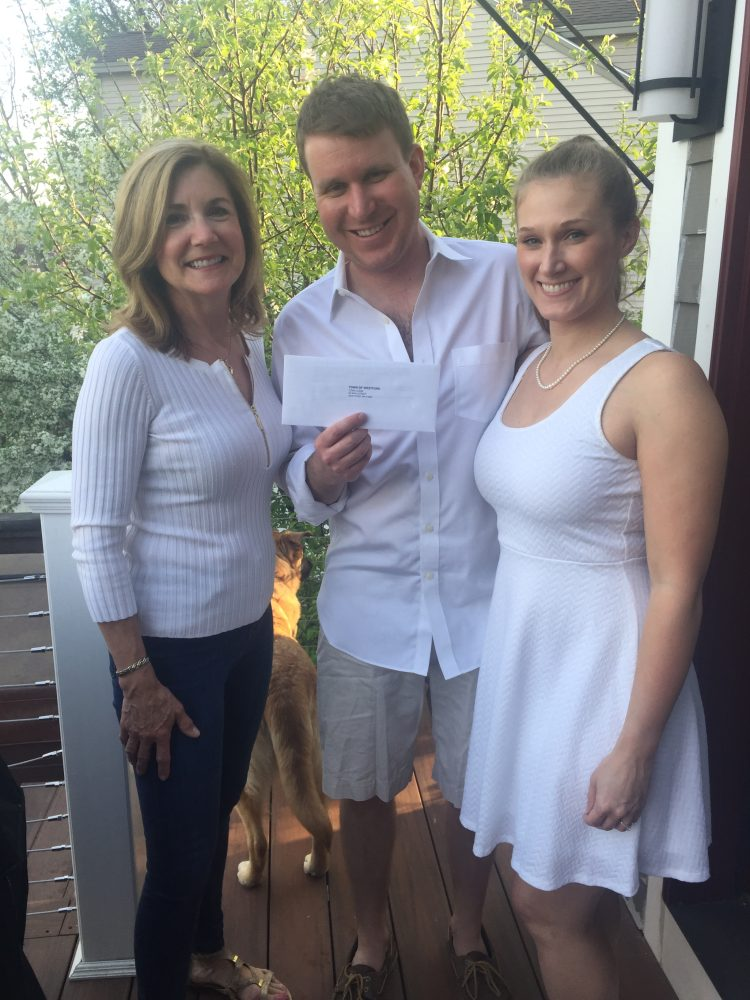 D.J. Orton (center) holds the marriage license delivered on May 10 by Westford Town Manager Jodi Ross (left). Orton is now married to Jessica Bush (right). COURTESY PHOTO