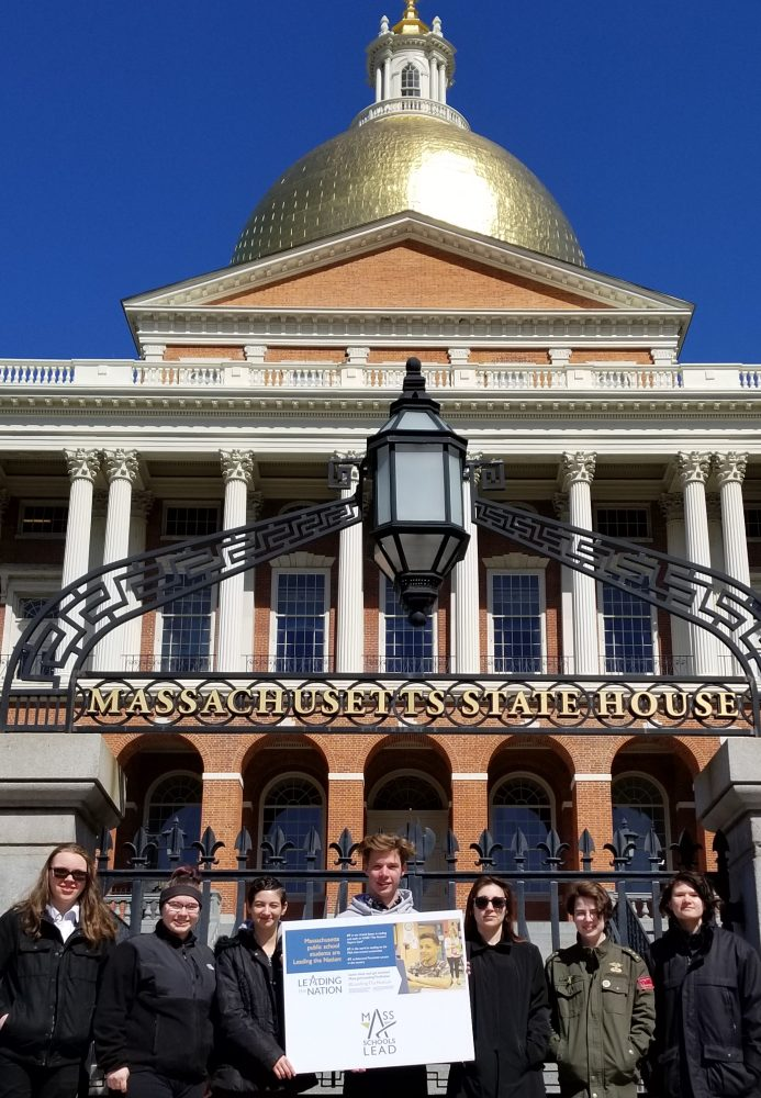 "Holding a ""Leading the Nation"" poster in front of the Massachusetts State House are Nashoba Tech students, from left, Emily Hogan (junior, Dracut), Cheyanne Thistle (senior, Pepperell), Laryssa Tervail (senior, Pepperell), Adam Kubasti (junior, Chelmsford), Shelby O'Rourke (senior, Chelmsford), Cailtin McMaster (junior, Chelmsford) and Rachel Cieslik (senior, Pepperell). COURTESY PHOTO"