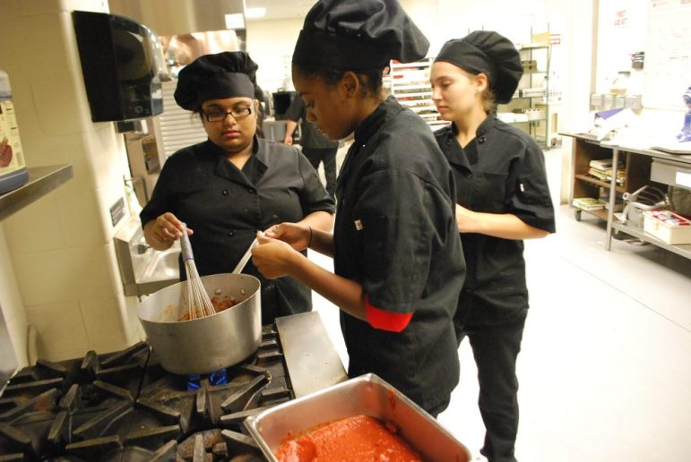 Nashoba Tech students, from left, Mim Rahman (postgraduate, Westford), Aaliyah Barry (sophomore, Pepperell) and Addison Cosker (sophomore, Shirley), prepare barbecue sauce in the kitchen of the school's restaurant, The Elegant Chef, which has reopened for the school year. COURTESY PHOTO