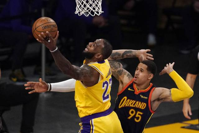 LeBron's 3 lifts Lakers over Warriors in West play-in game