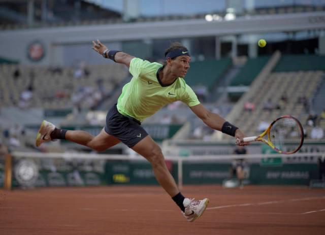Djokovic, Nadal win to reach French Open quarterfinals