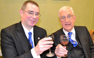 Steve McClintock (left) sharing a toast with Doug Willoughby.