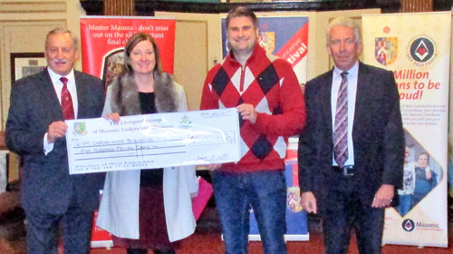 Pictured from left to right, are: Sam Robinson presenting the cheque to Tracey Kelly and her colleague from the 'Rare Chromosome Disorder Group', together with Liverpool Group Chairman Mark Matthews.